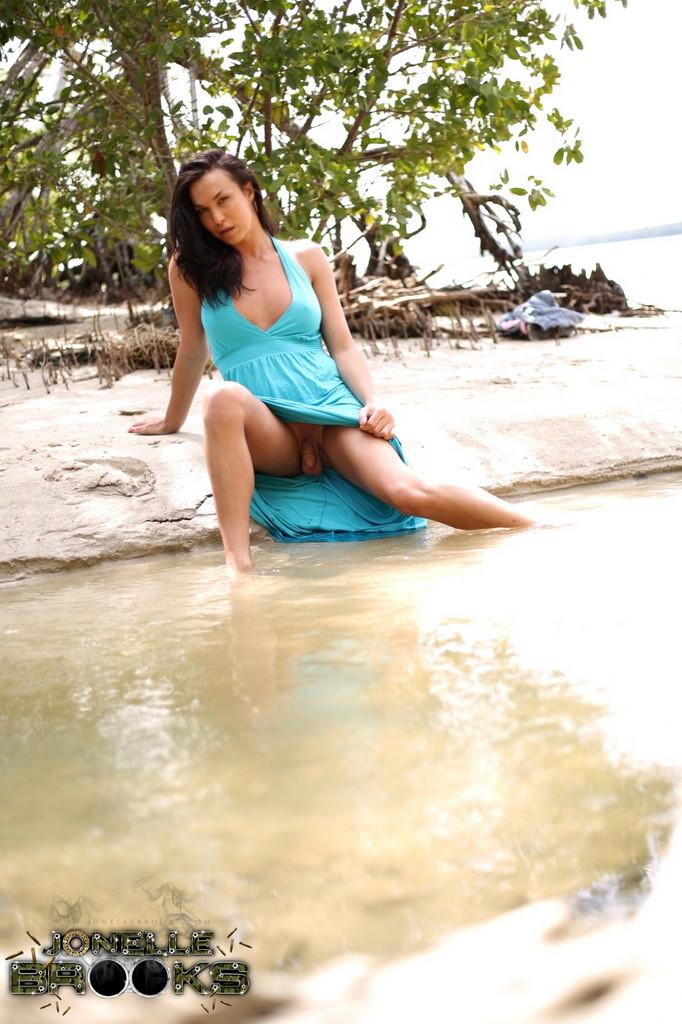 Arousing Jonelle Strips On A Lagoon