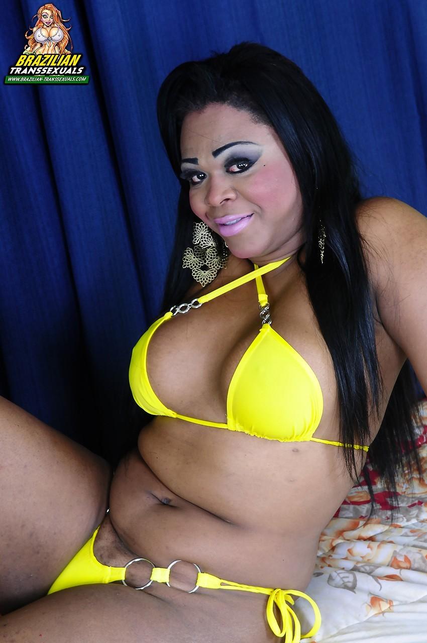 Black Shemale Rayssa Tropo In Yellow Swimsuit Exposing Her Big Dick