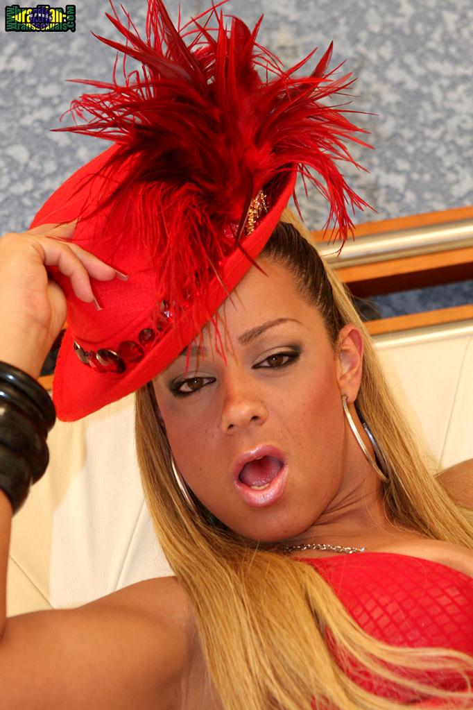 Blonde Brazilian TGirl Bruna Gabanna In Red Hat