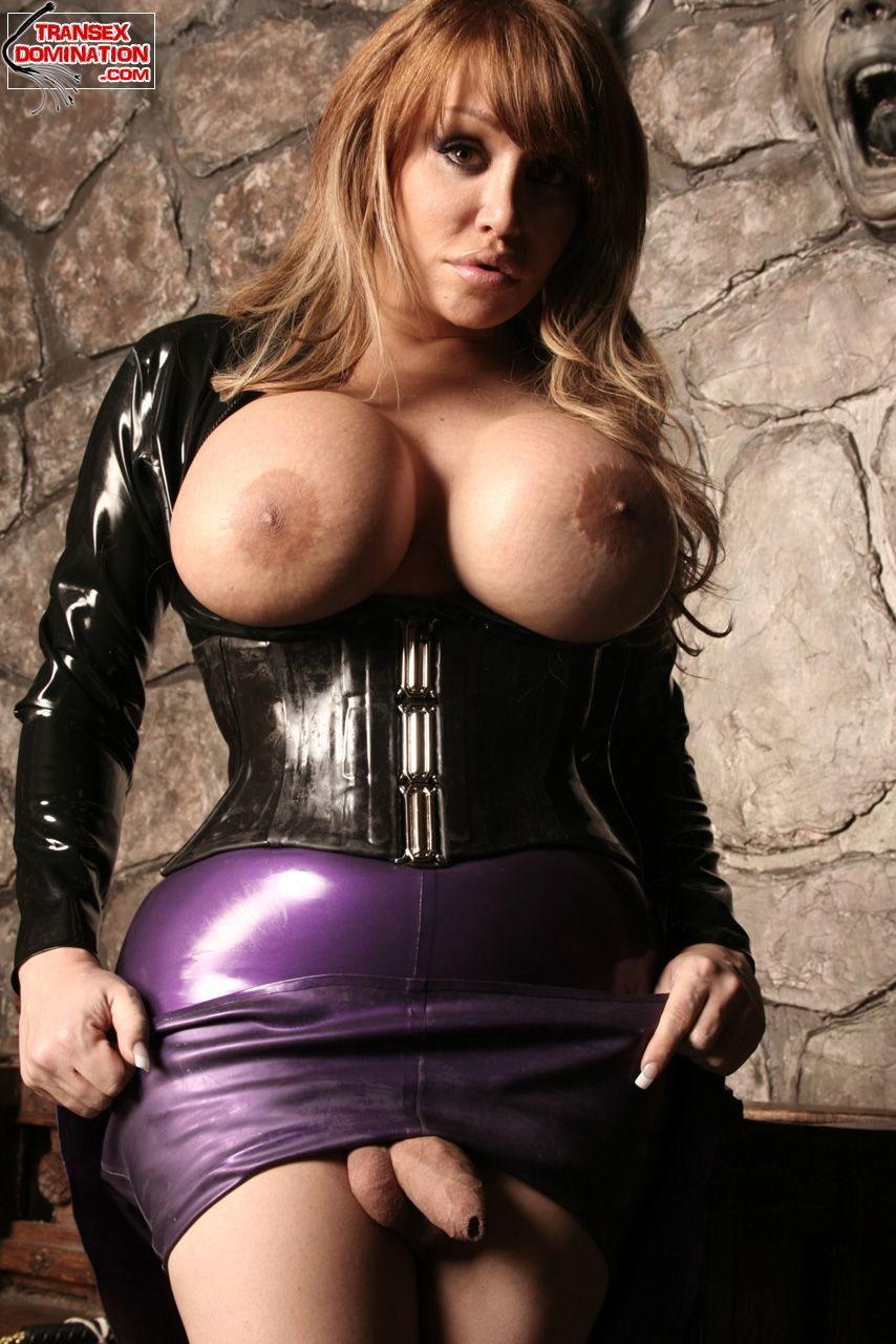 busty tgirl babe in latex corset posing
