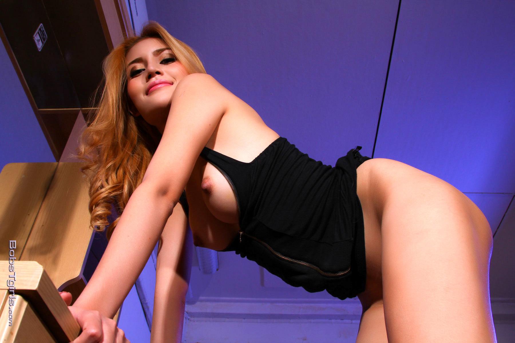 Flirtatious Honey Stroking Her Enormous Penis
