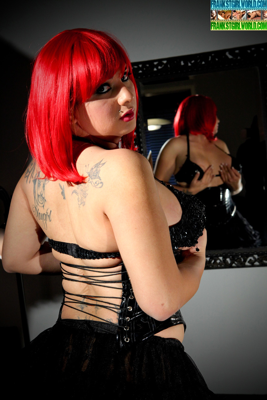 flirtatious tgirl stephany as a redhaired in corset