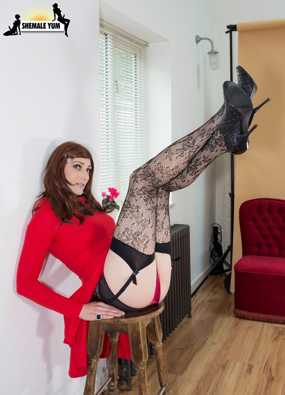 katie wales posing in red skirt