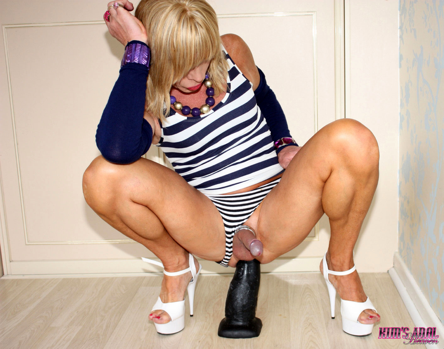 Kim Is Dressed In A Provoking Stripey Top And She Is Playing With Her Monster Toys Today