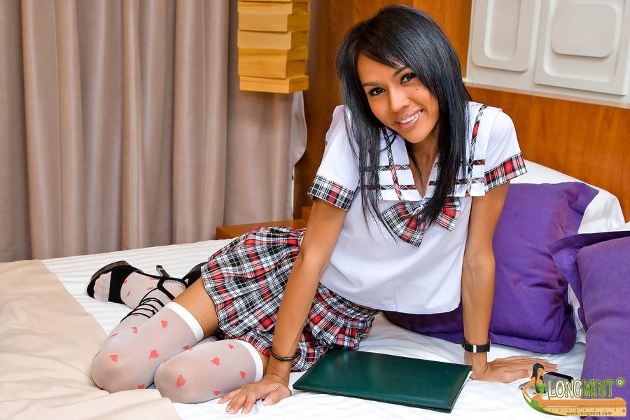 Longmint Teasing In School-Girl Uniform On The Bed