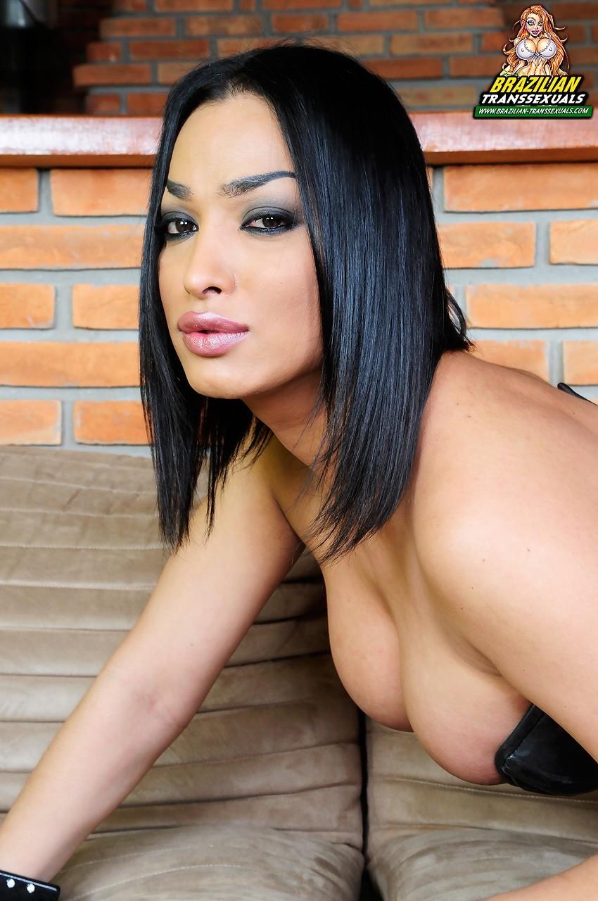 Monik Loran Racy T-Girl Posing In Corset