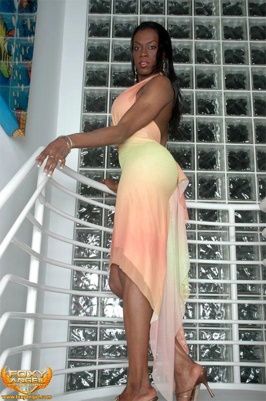 Nefertiti Ebony Tranny With Enormous Boobies On The Stairs