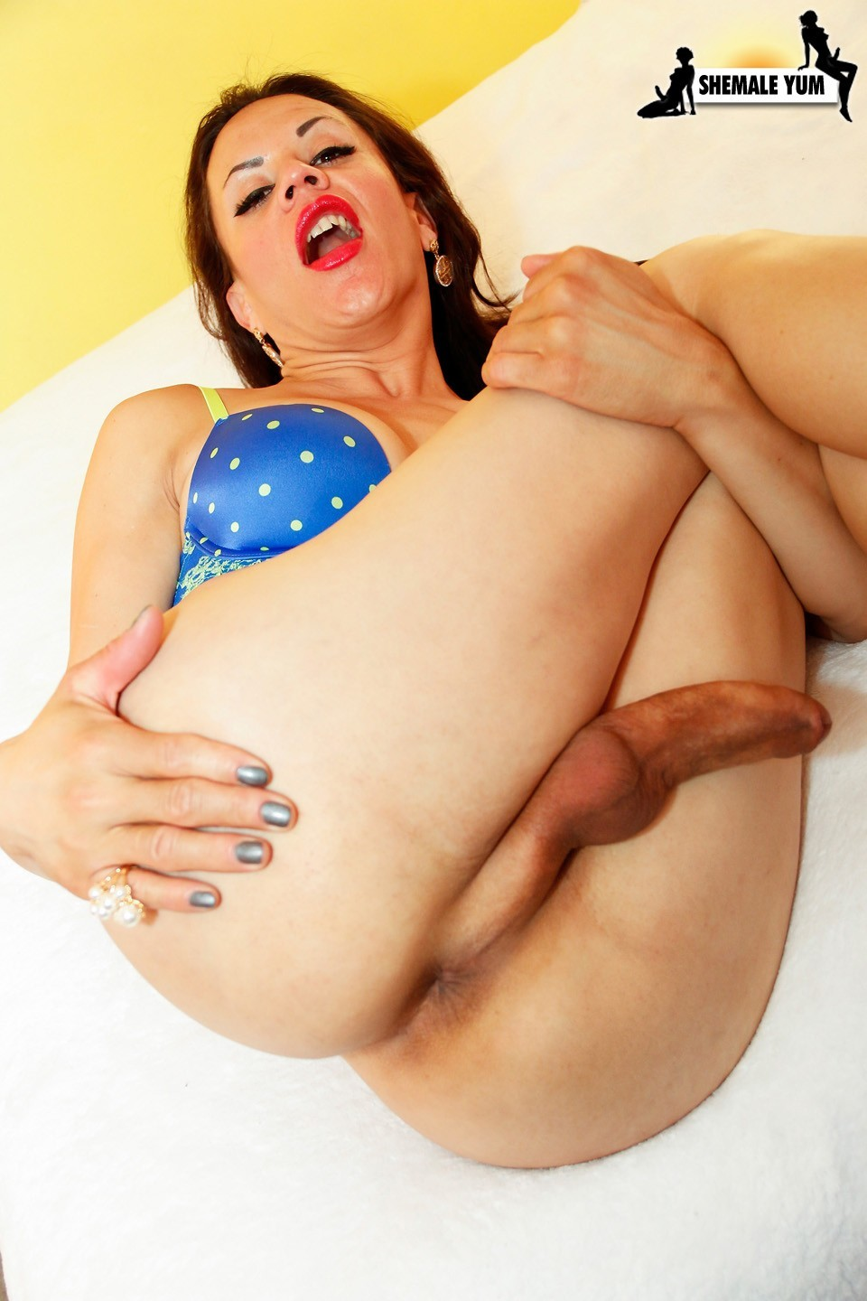 patricia fingering and stroking her dick in polka dot panties