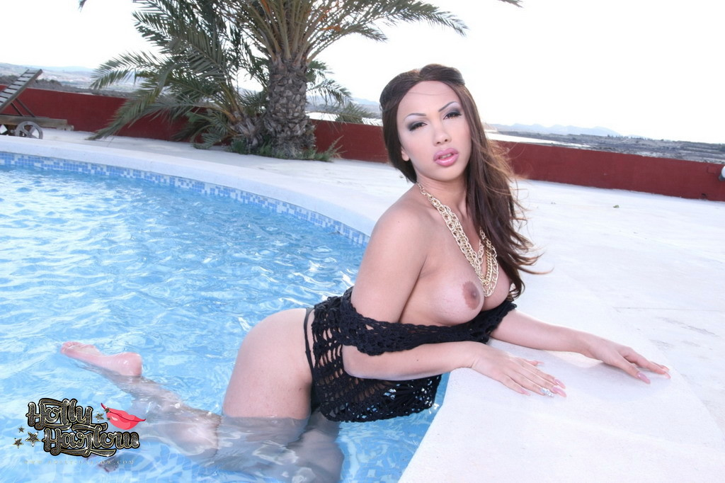 Seductive Holly Stripping By The Pool