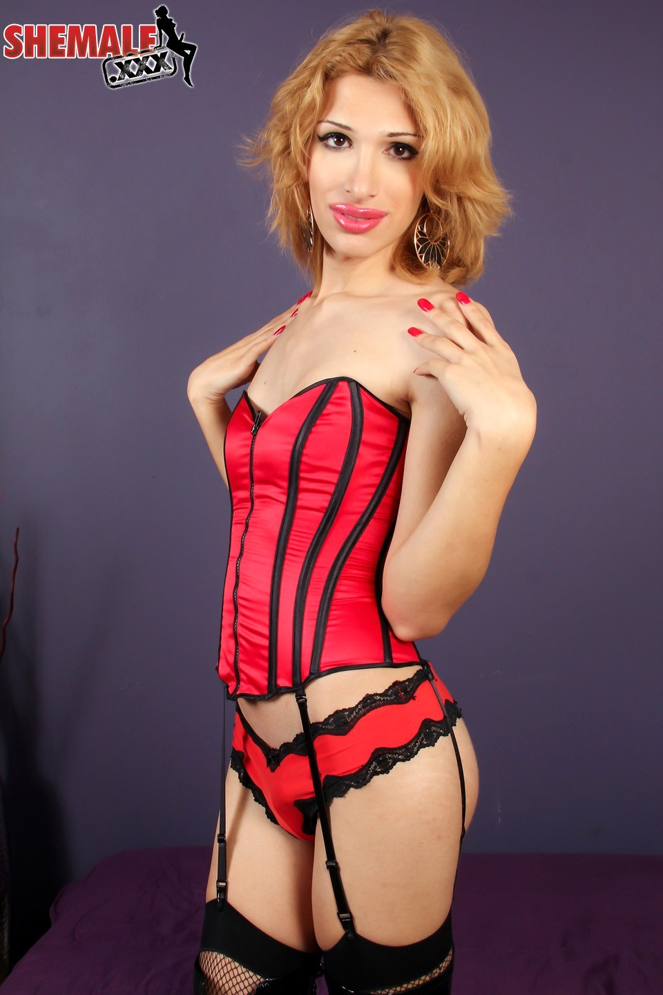 spicy alexis posing in red corset
