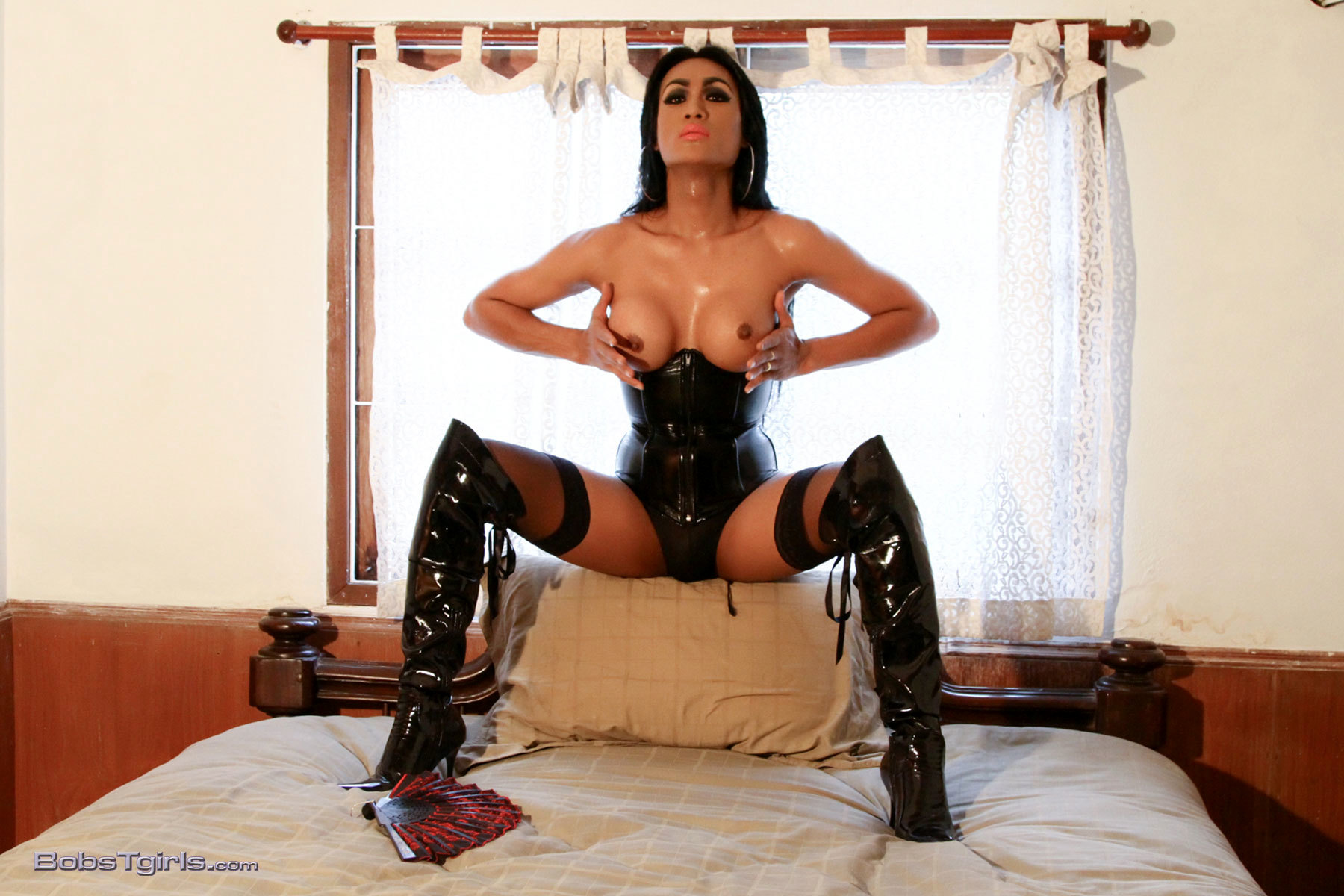 Steamy Amy Posing In Corset & Boots