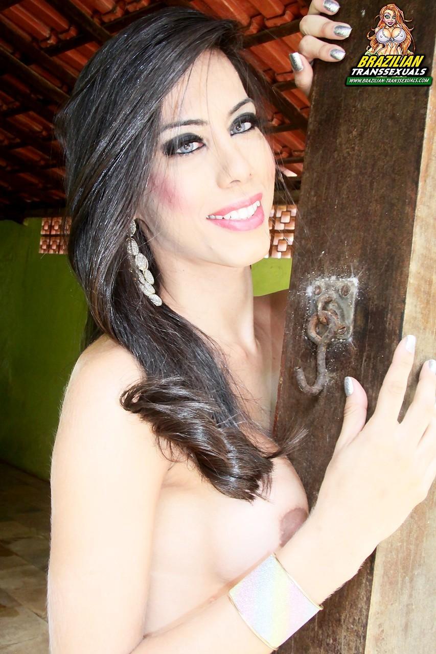 Suggestive Ladyboy Renata Sales Posing In Pink And Stroking Her Penis