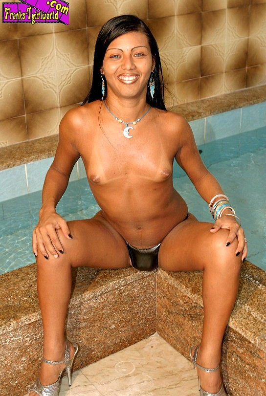 tgirl bruna indianara posing by the pool