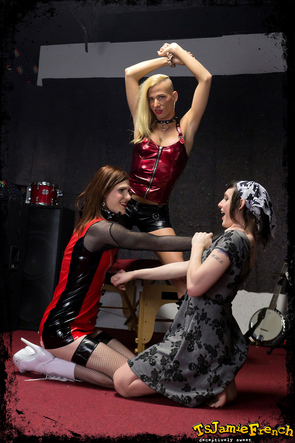 three provoking ladyboys tied