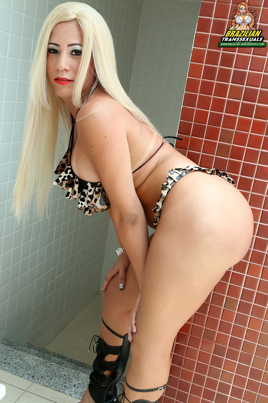 Titillating Brazilian T-Girl Enjoys Her Massive Juggs