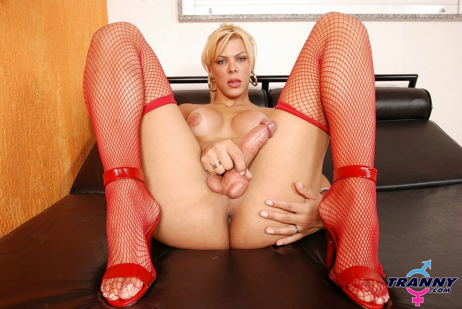 transexual in sensual red outfit gets naked and jerk