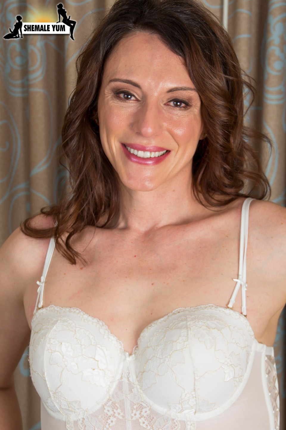 vivian grey posing in white corset and panties